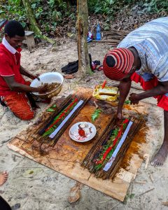Shows Bwiti Ngangas making torches that are used for ceremony