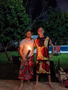 Shows Iboga Providers Michael Cassidy and Ryan Rich with a torch in hand pre-ceremony.