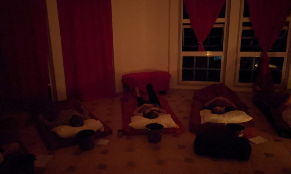 Iboga retreat participants lay down.